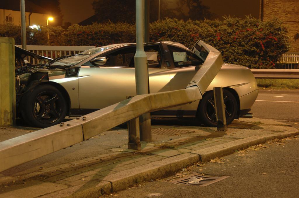 Car crashed under barrier