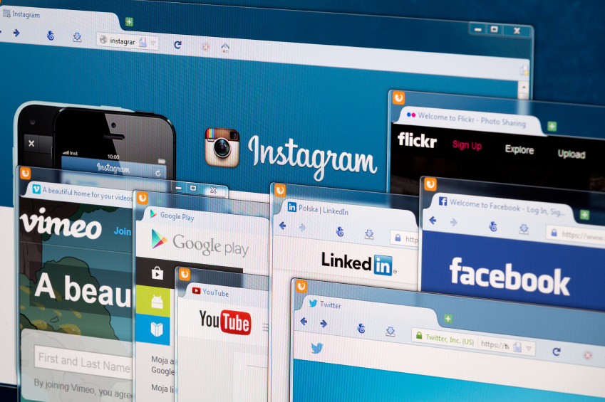 Social network homepage on a monitor screen.