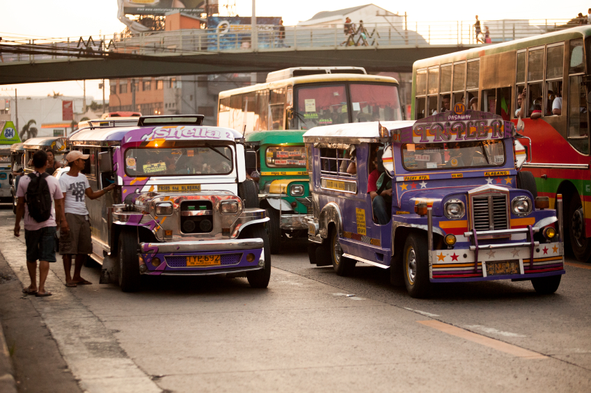Colourful Jeepney vehicle makes its way through traffic in Metro Manila.