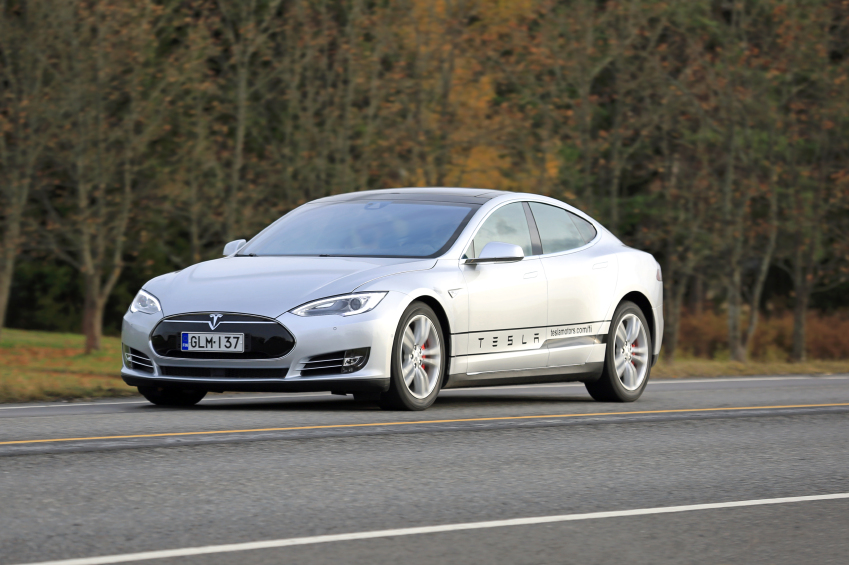 Silver Tesla Electric Car On the Road