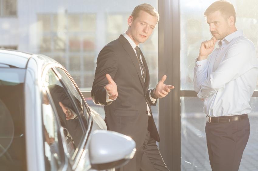 Car dealer offering expensive vehicle
