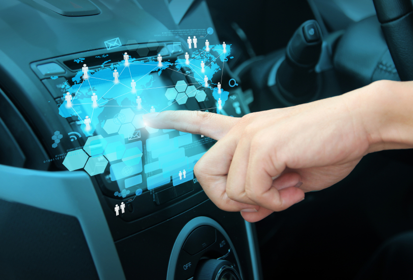 Pushing on a touch screen interface navigation system in interior of modern car