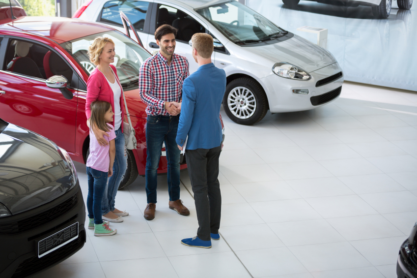 car agent congratulate the family on buying car