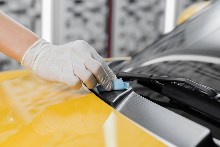 After applying a dressing to car trim, wipe away the excess residues and check out the shine!