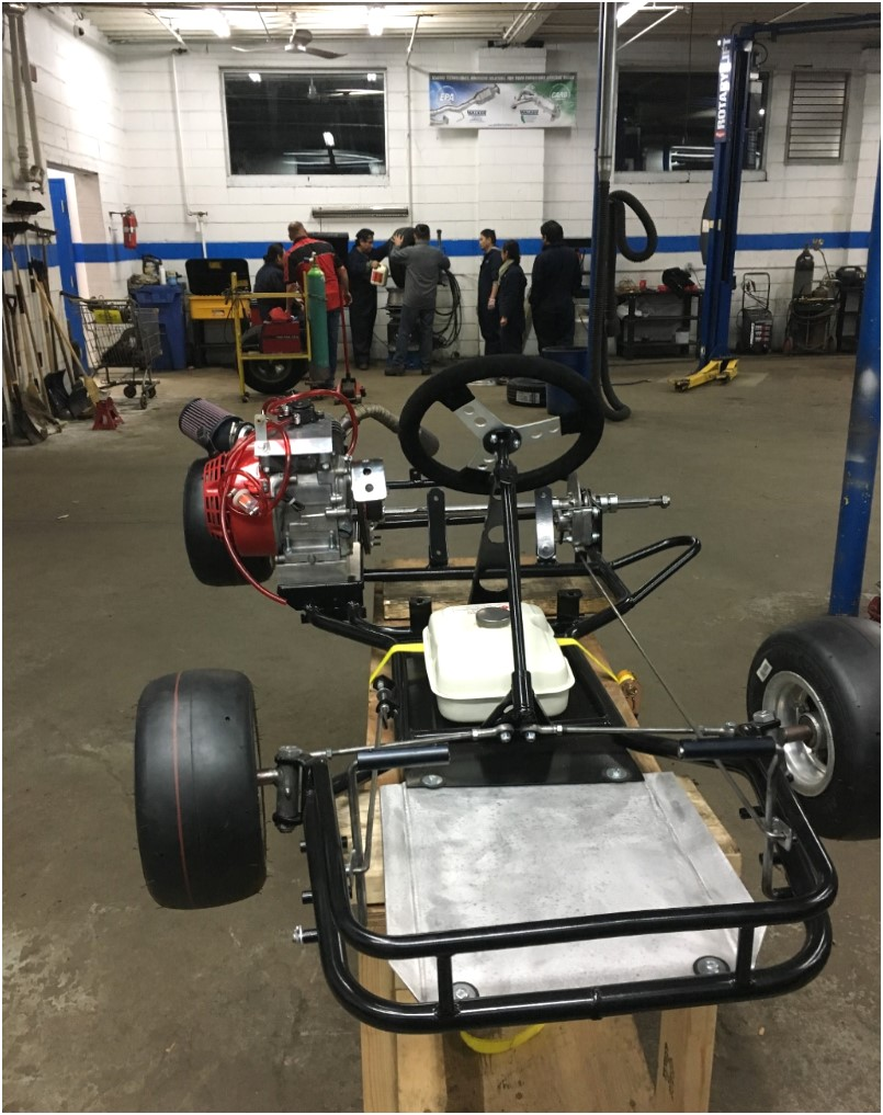 The finished, track-worthy go-kart, with vintage rims and new tires