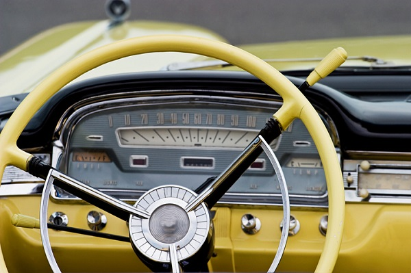 Many vintage cars have prominent metal dashboard components
