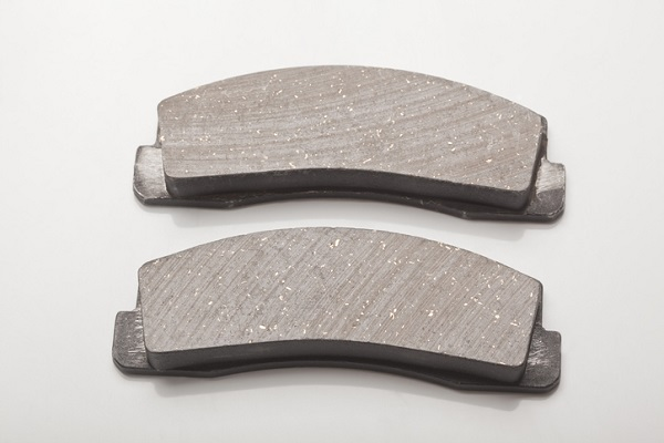 Make sure you don't let grease come in contact with the front of brake pads