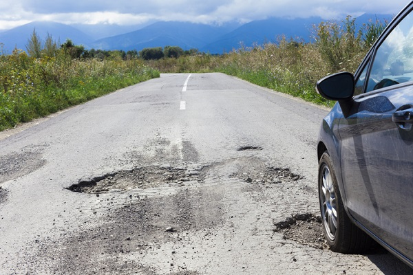 Car owners benefit from cautious driving, including slowing down over potholes