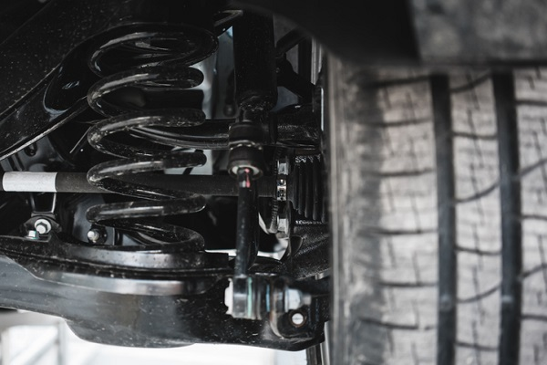 The front axle not only carries the weight of the car, but absorbs shocks from the road