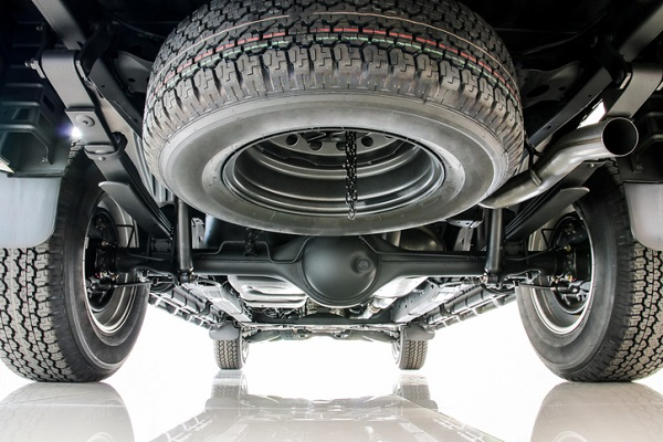 The car's rear axles revolve alongside the wheels and are usually live axles